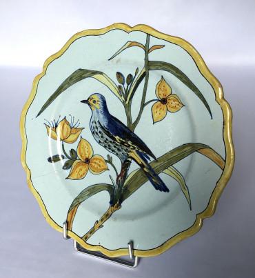 Assiette Porquier-Beau à décor d'oiseau
